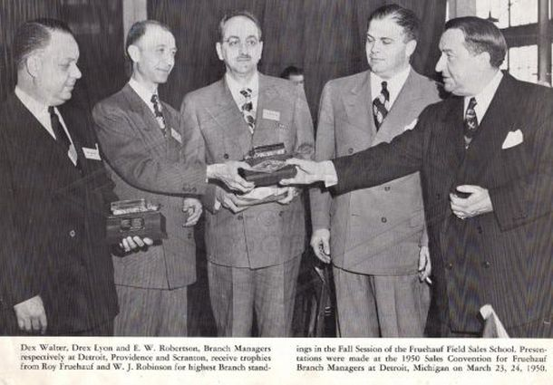 Dew Walter, Drex Lyon, and E.W. Robertson, branch managers, respectively at Detroit, Providence and Scranton receive trophies from Roy Fruehauf and W. J. Robinson